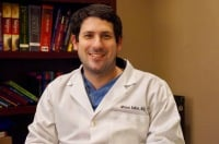 Dr. Michael Sutker in his clinic office